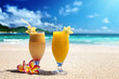 fresh fruit juices on a tropical beach - 61788344