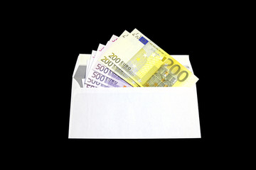 Several Euro banknotes in a white envelope