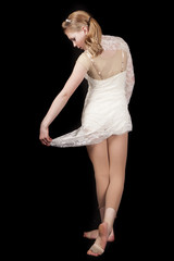 young girl dance hold skirt out