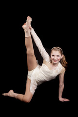 young girl dance holding leg up
