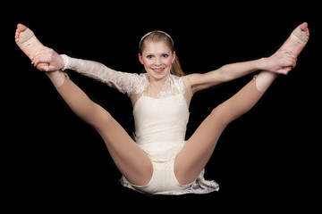 young girl dance sit hold legs up