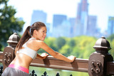 Running woman stretching after jogging in New York
