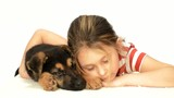 Sleeping little girl tenderly embraces a dog