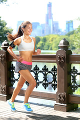 Running woman jogging to music in New York City