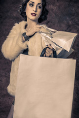 Vintage image of young woman with shoppingbags