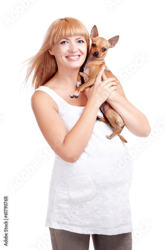Pregnant woman with a puppy dog