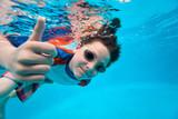 Boy swimming underwater