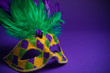 Leinwanddruck Bild - Mardi Gras or Carnivale mask on a purple background