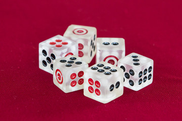 transparent dice on a red felt