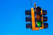 A green traffic light with a sky blue background - 61792900