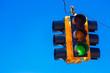 Leinwanddruck Bild - A green traffic light with a sky blue background