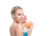Young blonde woman with grapefruit