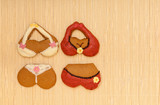 Funny colorful bikini gingerbread cookies on bamboo mat