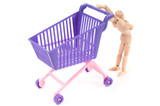 Photo with miniature shopping-cart and wooden man