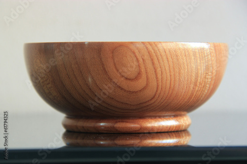 Wood cup on a glass top
