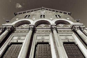 Church facade with arcs and columns