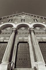 Tall church entrance with arcs and columns