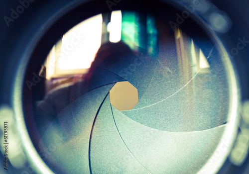 Diaphragm of a lens. Color toned image.