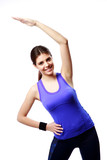 Young cheerful woman stretching isolated on white background