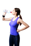 Young sport woman drinking water isolated on white background