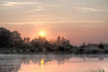 Sun rising over bog