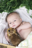 baby lying with fury toy poster