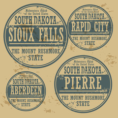 Grunge rubber stamp set with names of South Dakota cities