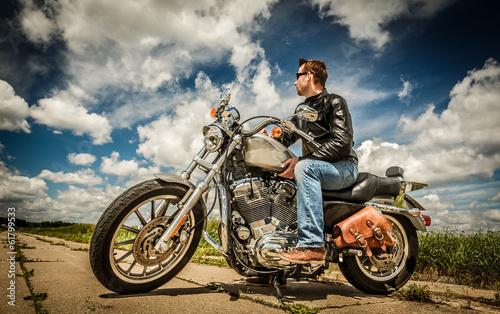 Biker on the road - 61799533