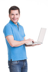 Portrait of young man with laptop.