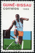 stamp printed in Guinea-Bissau showing Long Jump