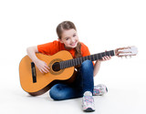 Cute girl plays on the acoustic guitar.