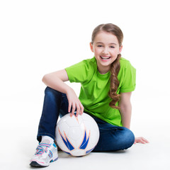 Smiling little girl sitting with ball.