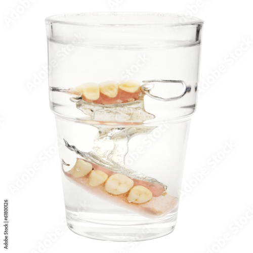 "False Teeth in a glass of water ""isolated on white"""