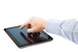 businessman hand touch tablet pc on table