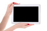 tablet pc with empty copyspace screen in female hands isolated o