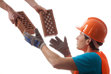 Builder taking bricks