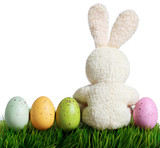 Colorful easter eggs and rabbit on grass, isolated