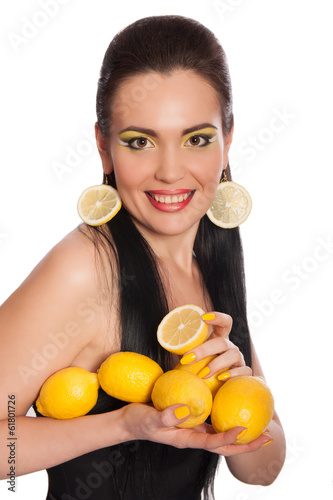 Pretty girl with lemons isolated on white