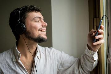 young stylish man lifestyle listening to music