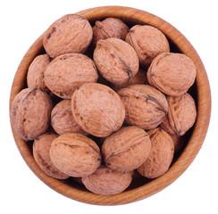 Wooden bowl full of walnuts