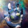 Earth and hand before cosmos