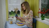 Woman prepare herb cornflower healthy tea and mix