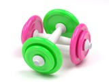 pink and green  dumbell on the white background