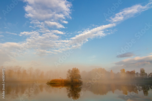 Autumn landscape and foggy  lake
