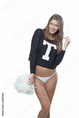 Happy young cheerleader with pom-pom isolated on white
