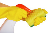 Hands in yellow gloves with a detergent on white