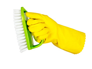 hand with yellow glove cleaning with brush on white