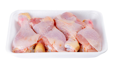 Fresh chicken legs isolated on a white