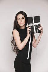 Elegant woman holding gift