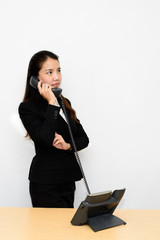 Thai business woman talking on a telephone